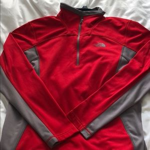 Red and grey north face pull over